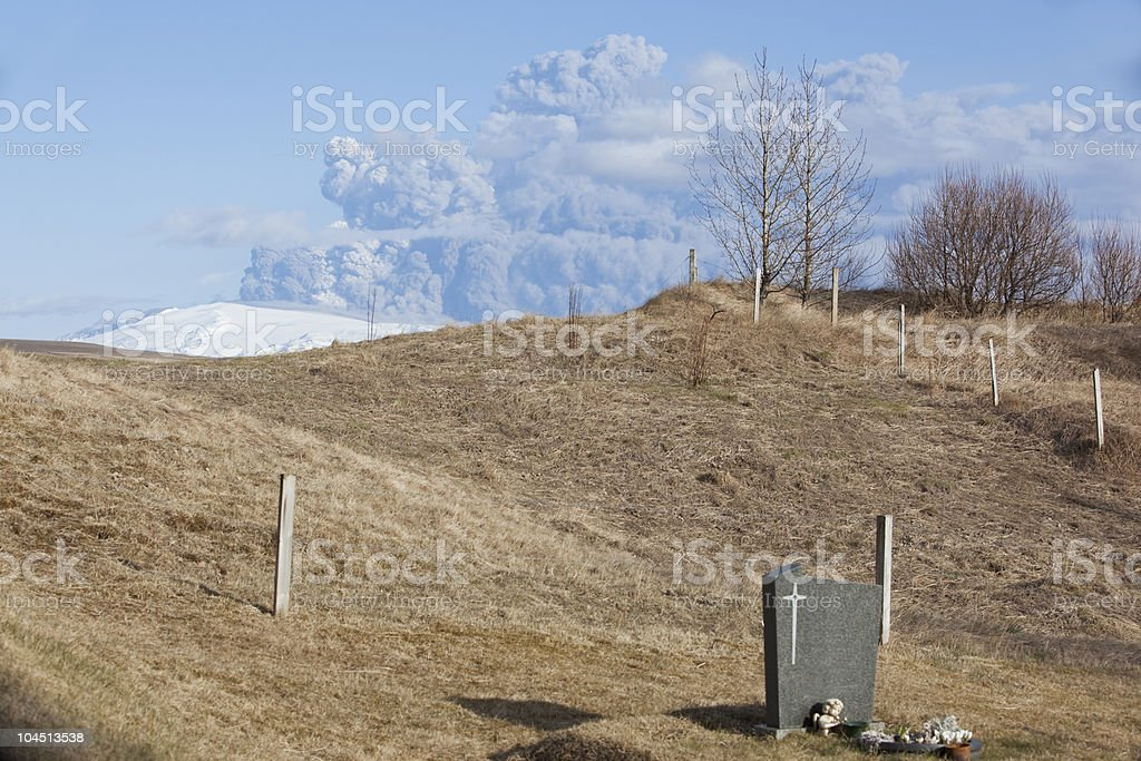 Gravestone in a churchyard under Erupting @ Iceland stock photo