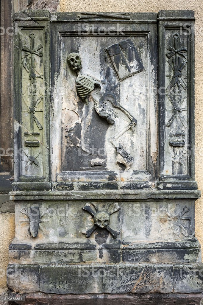 Gravestone With Dancing Skeleton stock photo