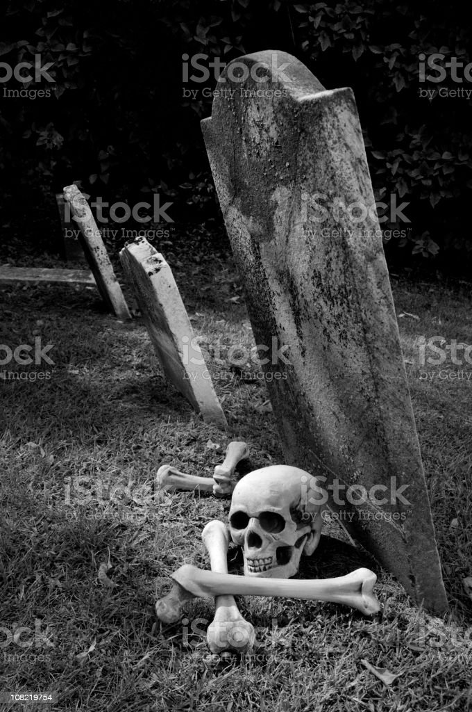 Gravestone with Skull and Crossbones, Classic Halloween Horror royalty-free stock photo
