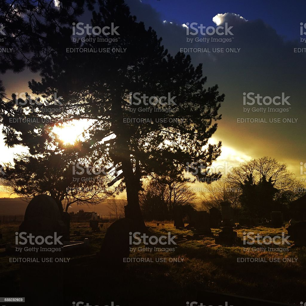 Graveyard sunset stock photo
