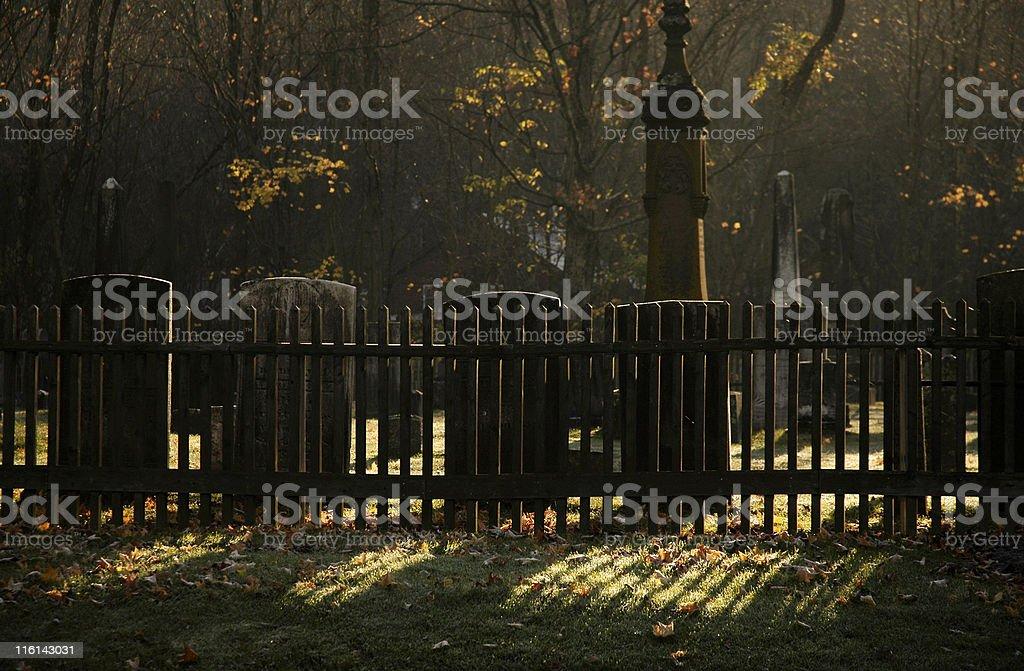 Graveyard Through Fence In Morning Sun royalty-free stock photo
