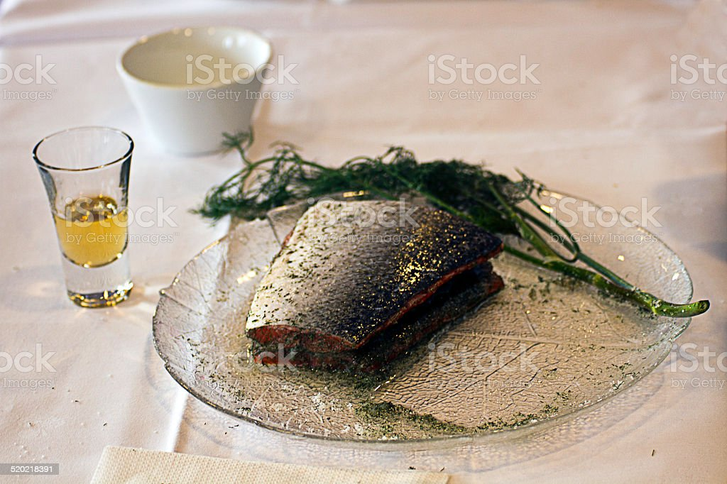 Gravlox, (salmon) on plate with aquavit stock photo
