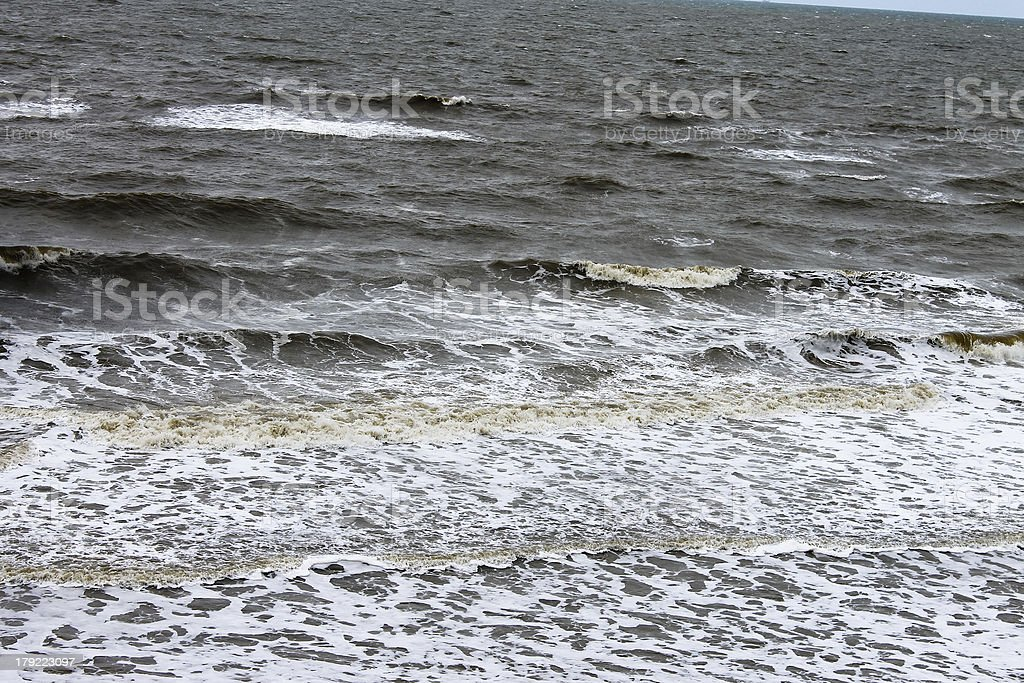 Gray autumn sea. Surf on the beach royalty-free stock photo
