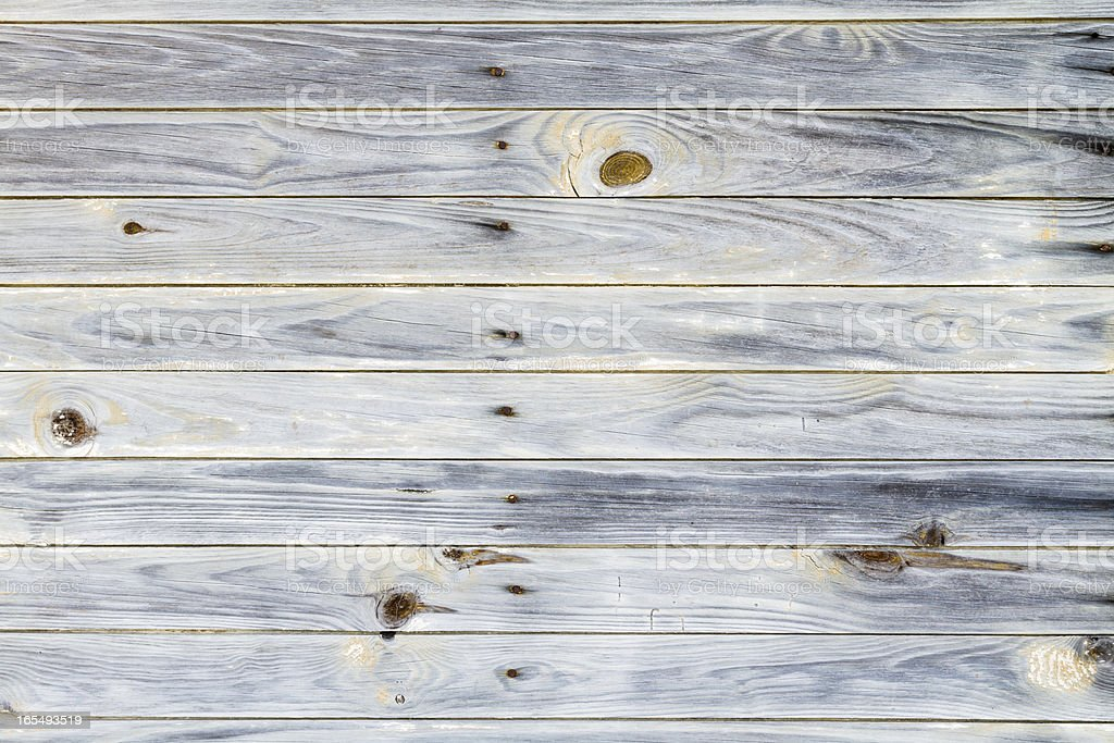 Gray background showing knots on wood royalty-free stock photo