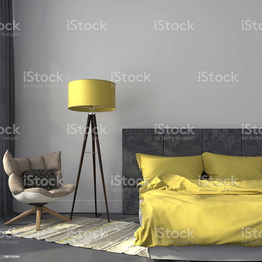 Gray bedroom and yellow decor stock photo