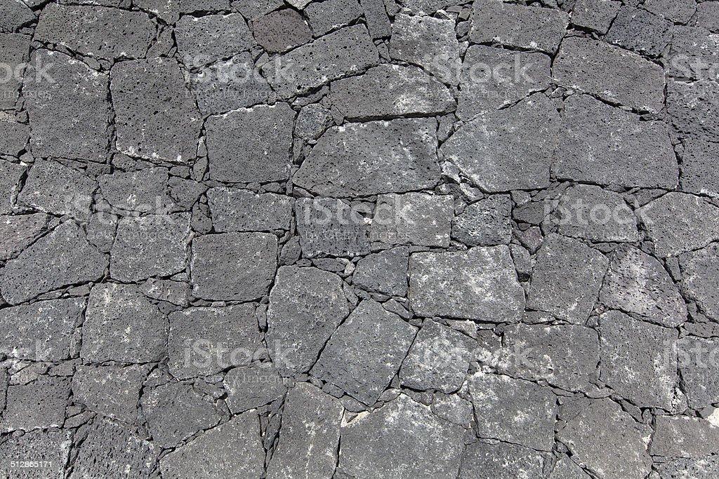 Gray Canarian natural stone wall royalty-free stock photo