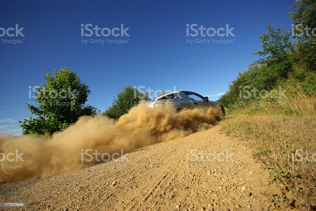 Gray car skidding on a sandy road stock photo