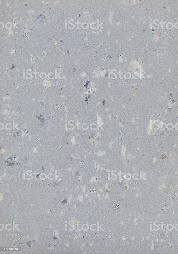 gray cardboard with newspaper scraps stock photo