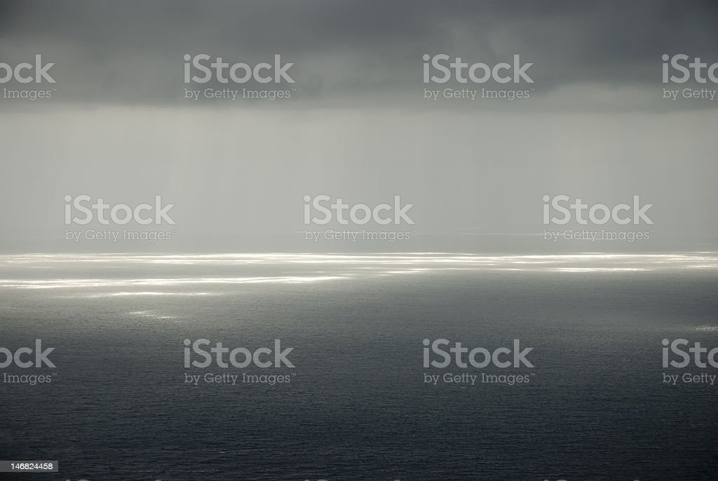 gray clouds and sunshine stock photo