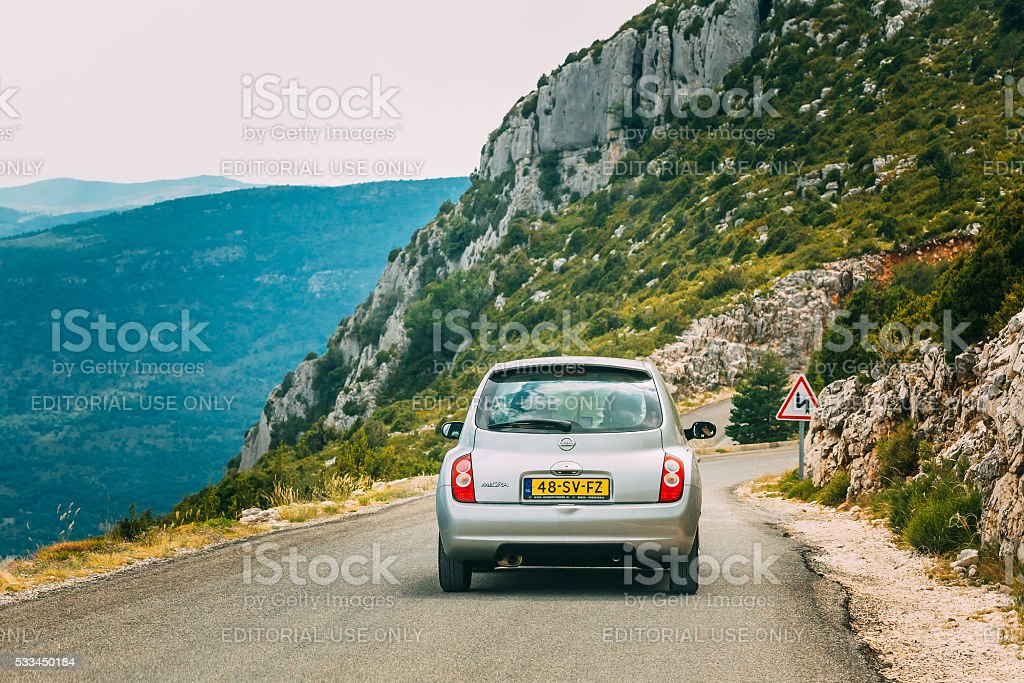 Gray colour Nissan Micra car on background of French mountain stock photo