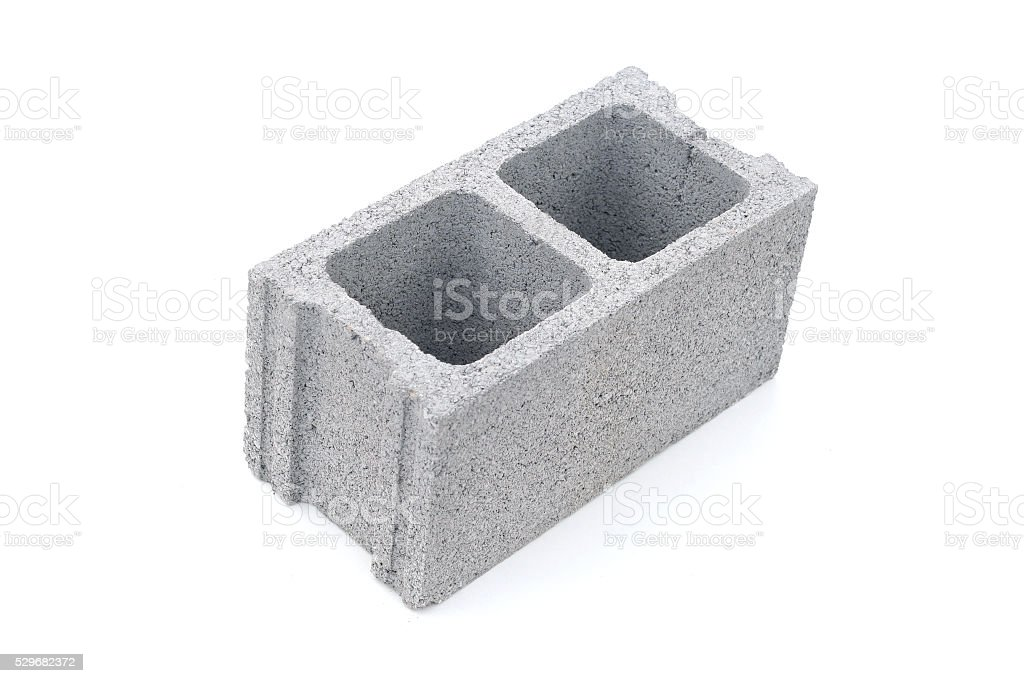 Gray concrete construction block isolated on white stock photo