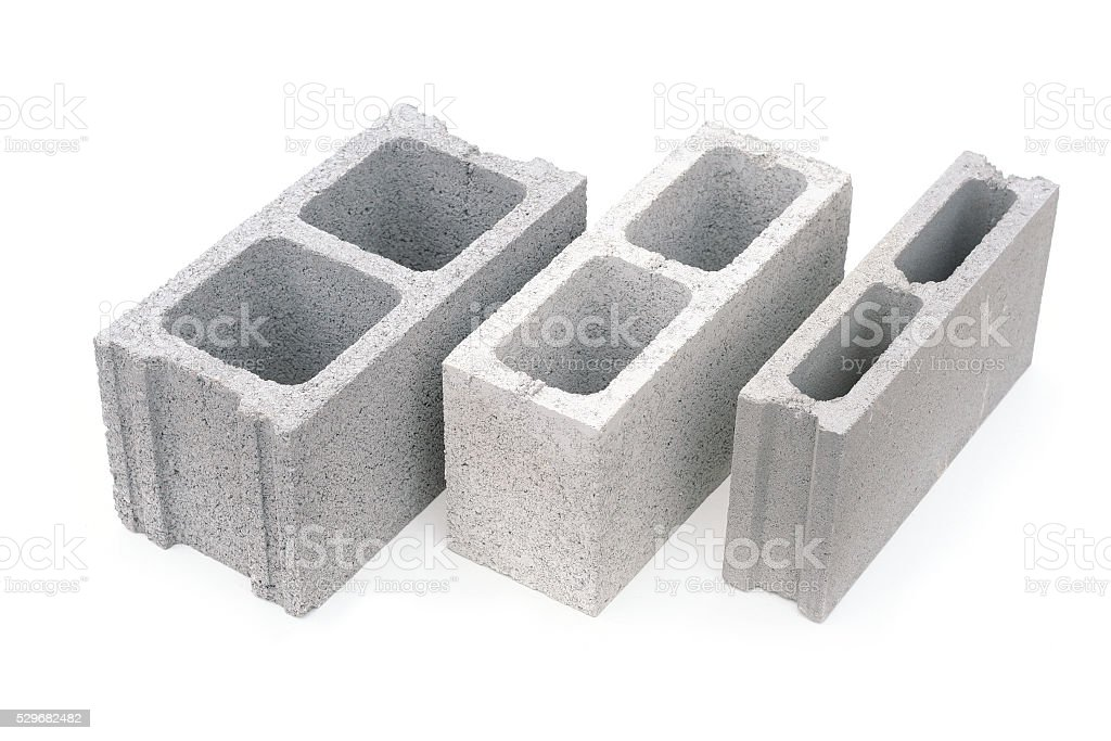 Gray concrete construction block isolated on white stock photo