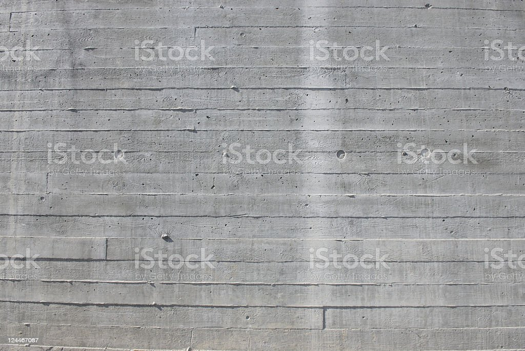 Gray concrete wall with line texture and white stripe royalty-free stock photo