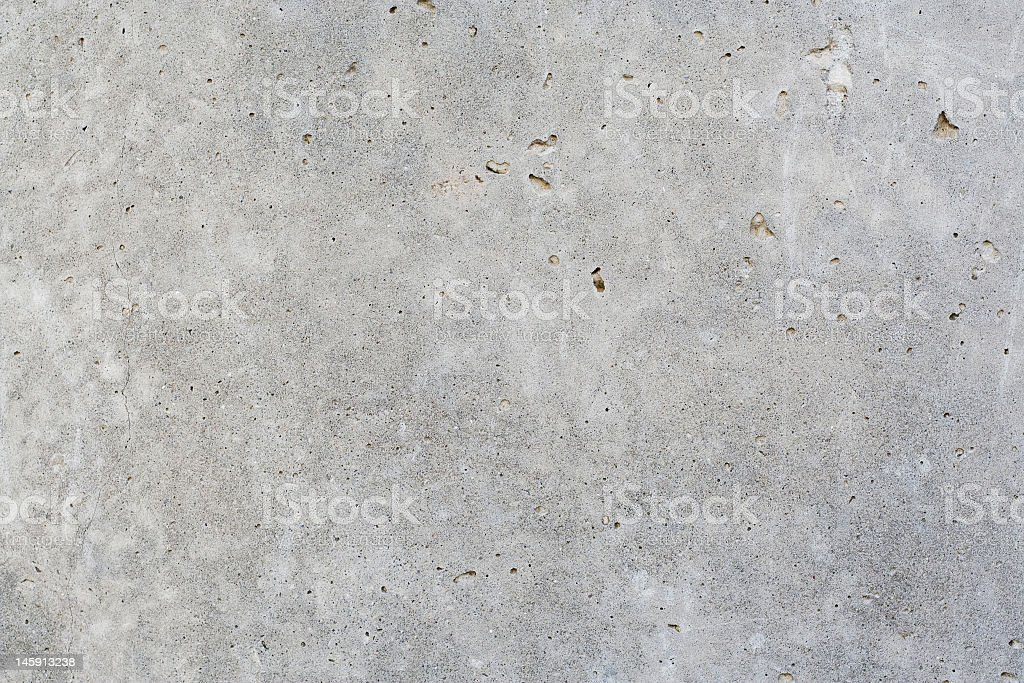 Gray concrete wall with small holes royalty-free stock photo