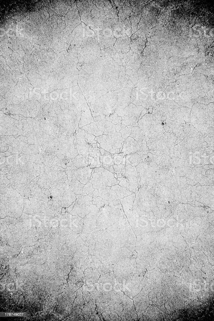 Gray concrete with cracks and black corners royalty-free stock photo