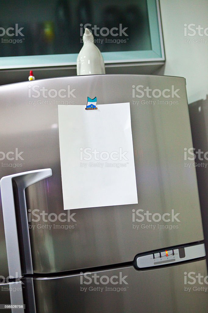 Gray Domestic Refrigerator with Penguin and Blank Paper for Notes stock photo