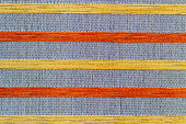 Gray fabric texture embroidered with orange and yellow stripes