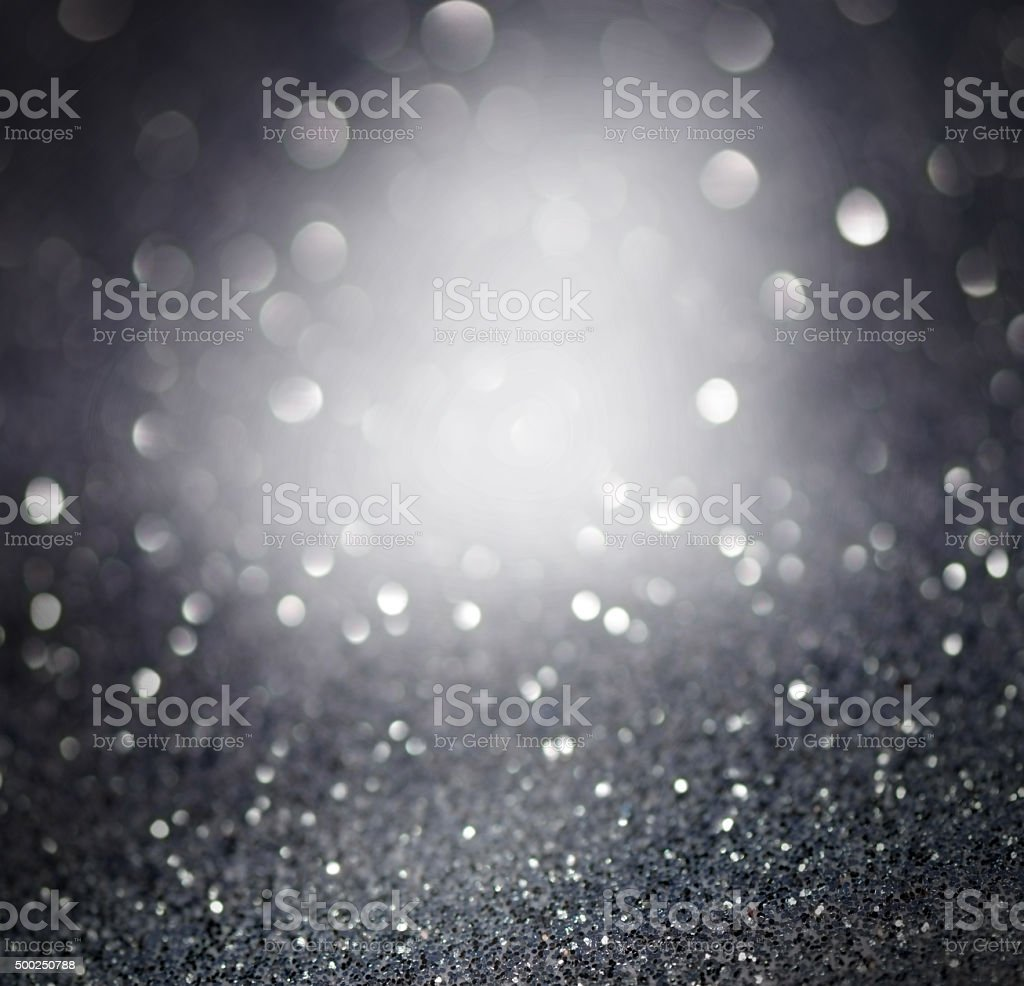 Gray glittering christmas lights. Blurred abstract background stock photo