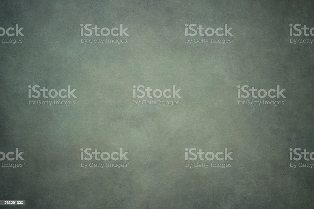 Gray green painted canvas or muslin fabric cloth studio backdrop stock photo