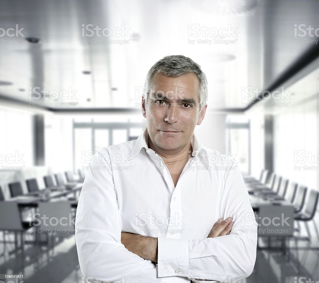 gray hair businessman interior white office stock photo