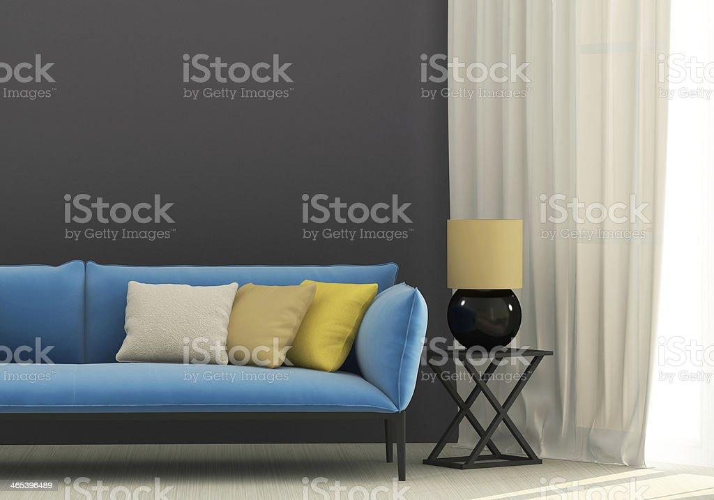 Gray interior with blue sofa stock photo