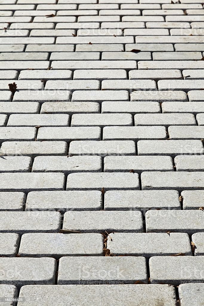 Gray interlocking paving stone driveway from above royalty-free stock photo