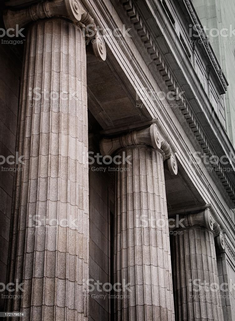 Gray ionic columns at the front of a traditional building royalty-free stock photo