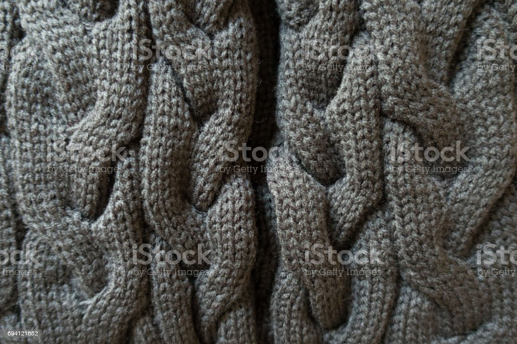 Gray knit fabric with plait pattern from above stock photo