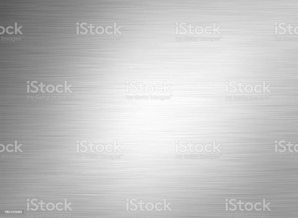 Gray metal background with light shining on it stock photo