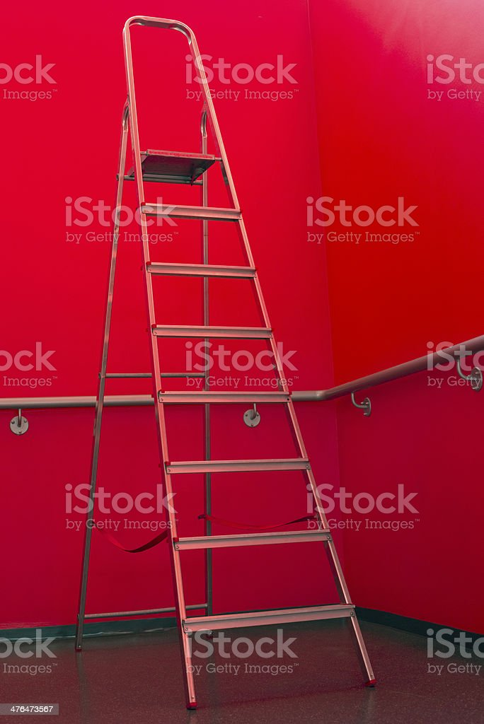 Gray Metal Ladder Against Red Wall royalty-free stock photo