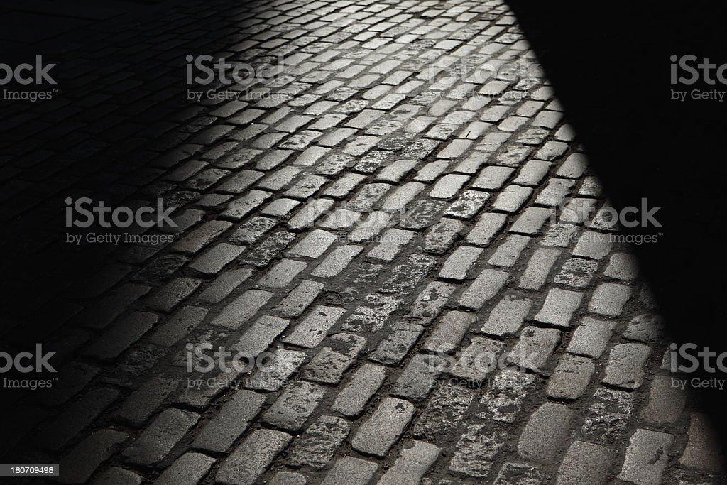 Gray night shadows cobblestones street royalty-free stock photo