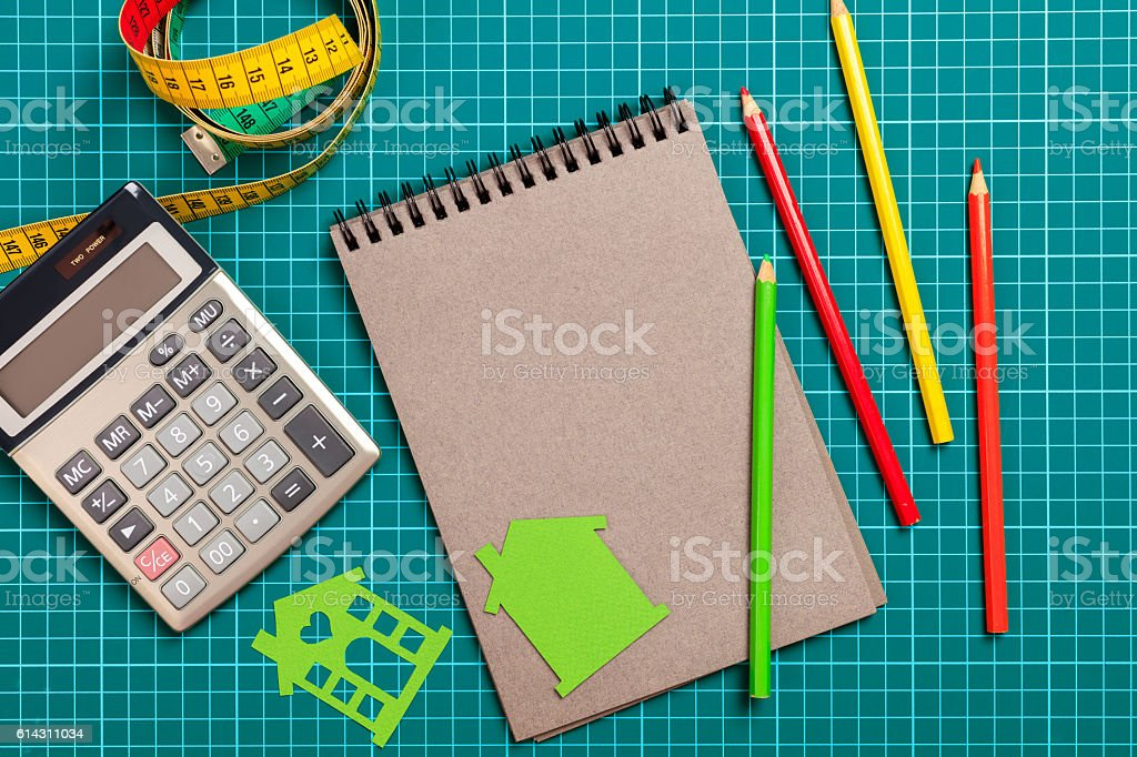 gray notepad on a green background stock photo
