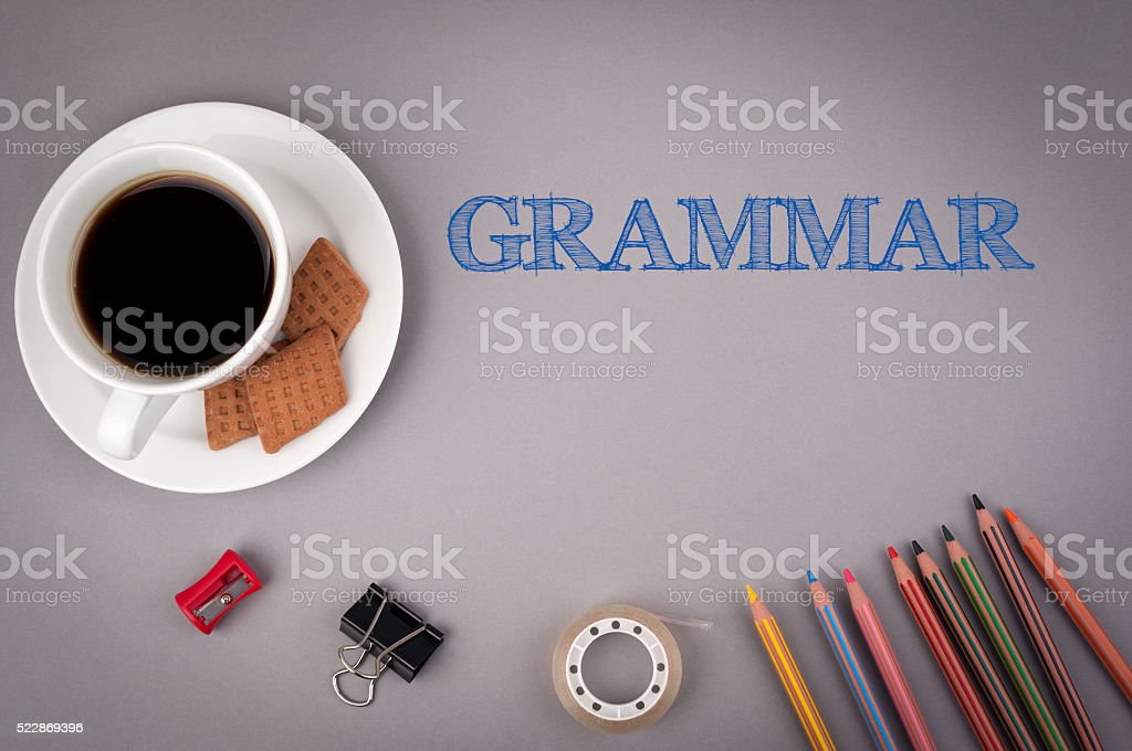 Gray office desk with the inscription - Grammar stock photo