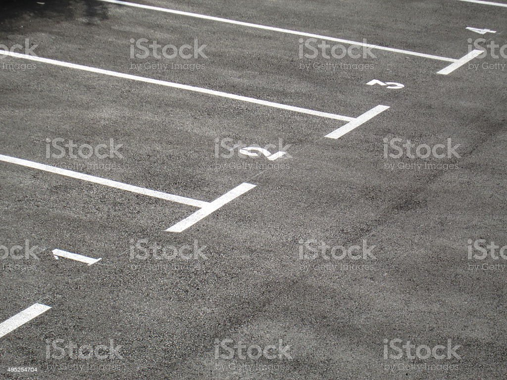 Gray parking area numbered one to four stock photo