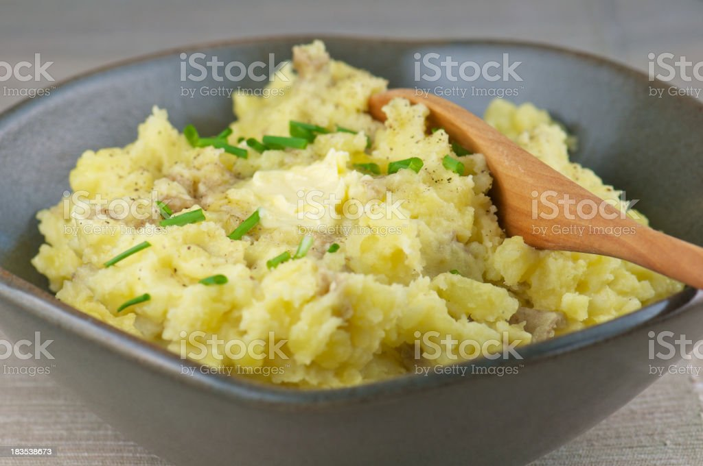 Gray Pottery Bowl of Buttery Mashed Potatoes royalty-free stock photo