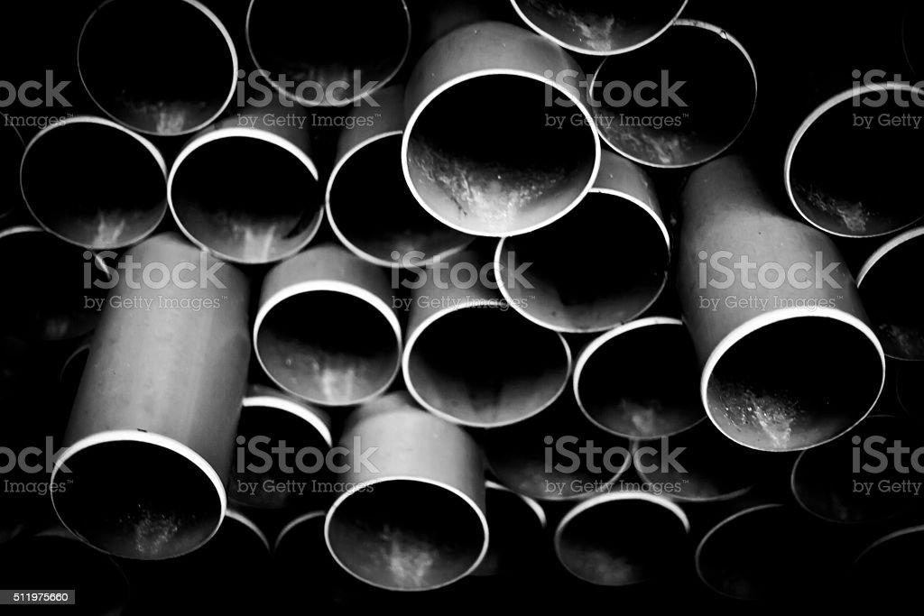 Gray PVC pipes stacked stock photo