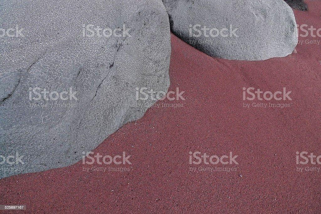 Gray rocks in the reddish sand royalty-free stock photo
