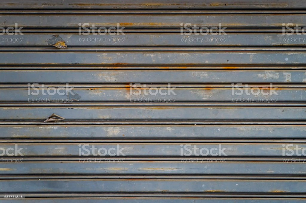 Gray Rustic store retail metal gate wall closed. stock photo