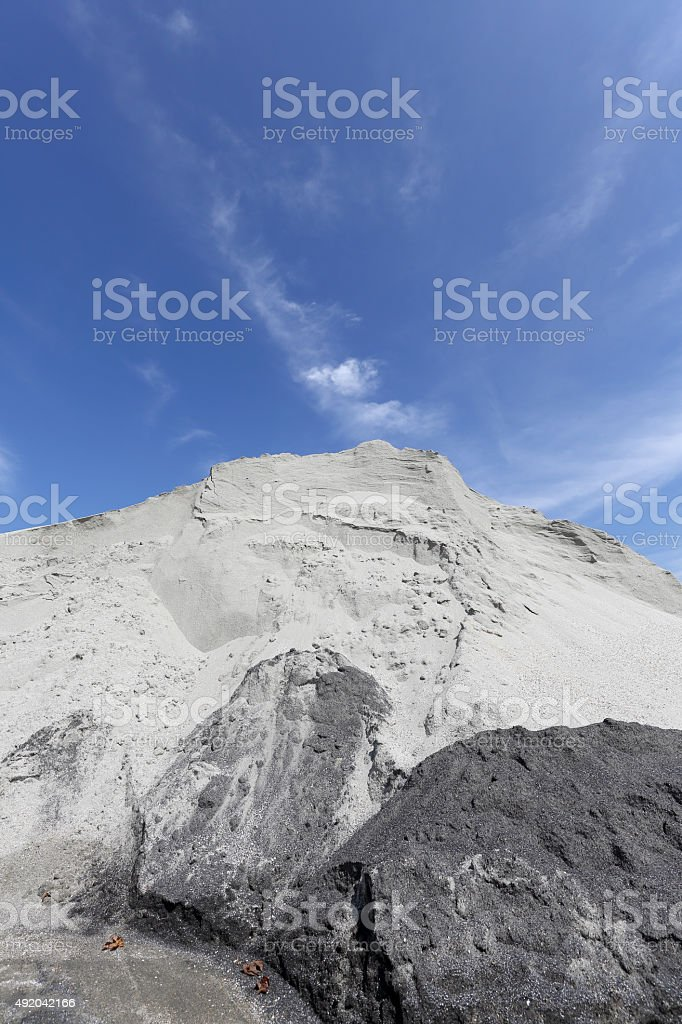 Gray sand mound stock photo