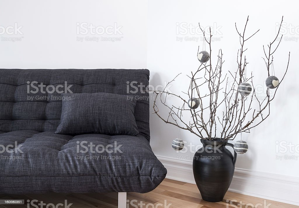 Gray sofa and simple winter decorations royalty-free stock photo