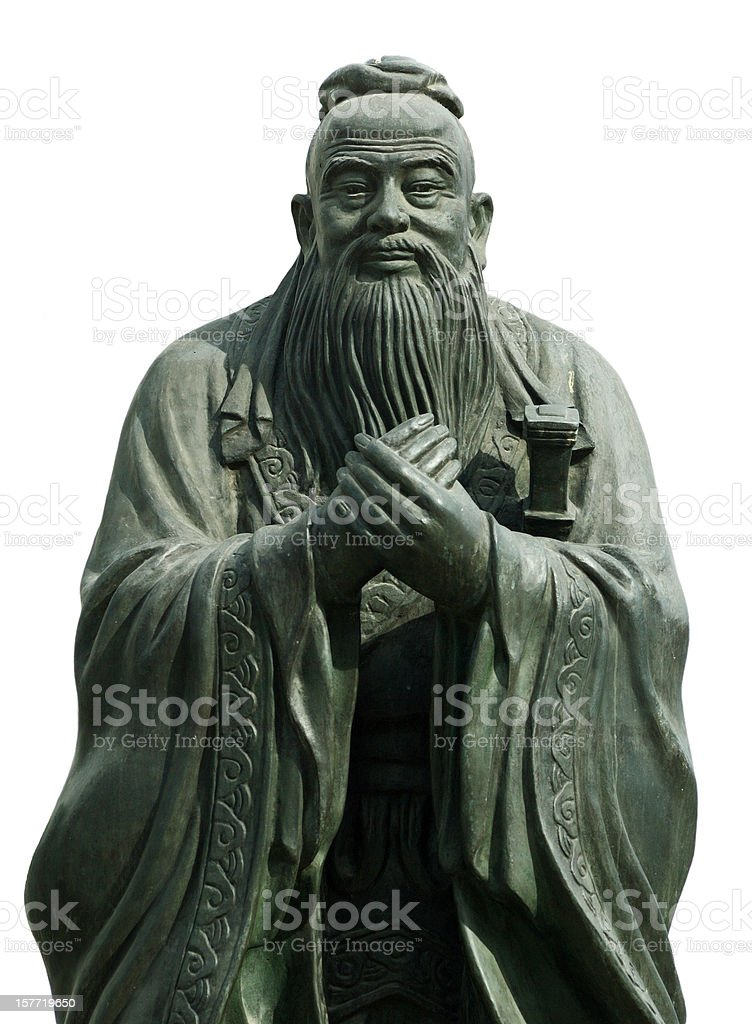 Gray statue of Confucious holding his hands together stock photo