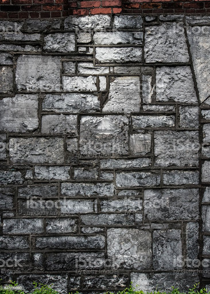 Gray Stone and Red Brick Aged Wall stock photo