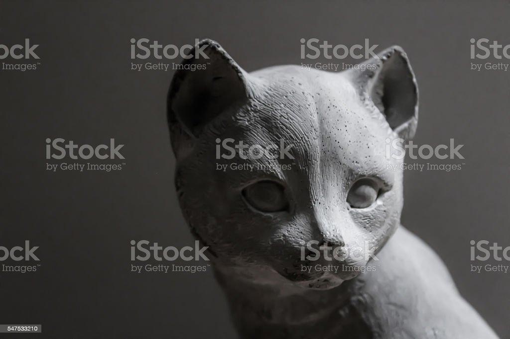 Gray stone cat stock photo