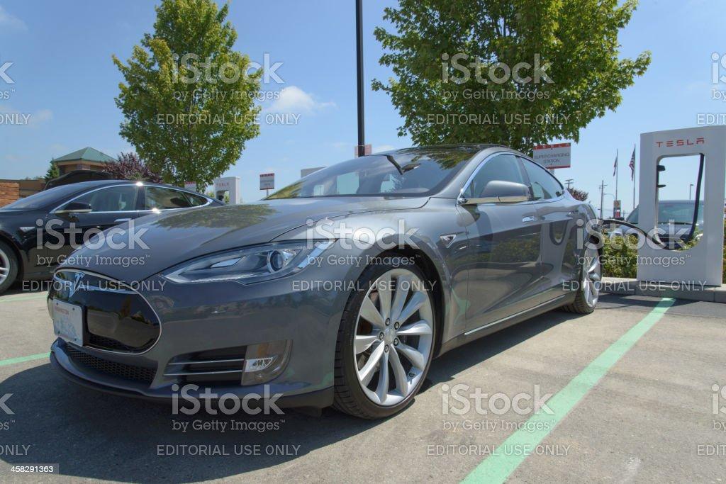 Gray Tesla Motors Model S Charging At Burlington Washington Supercharger stock photo