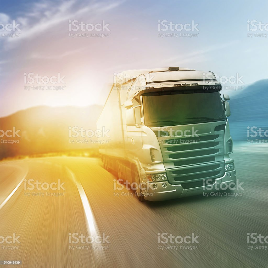 Gray truck on highway stock photo