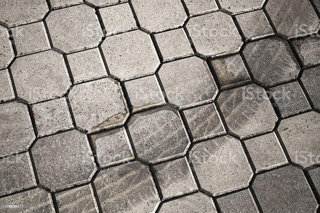 Gray urban cobblestone with tire track royalty-free stock photo