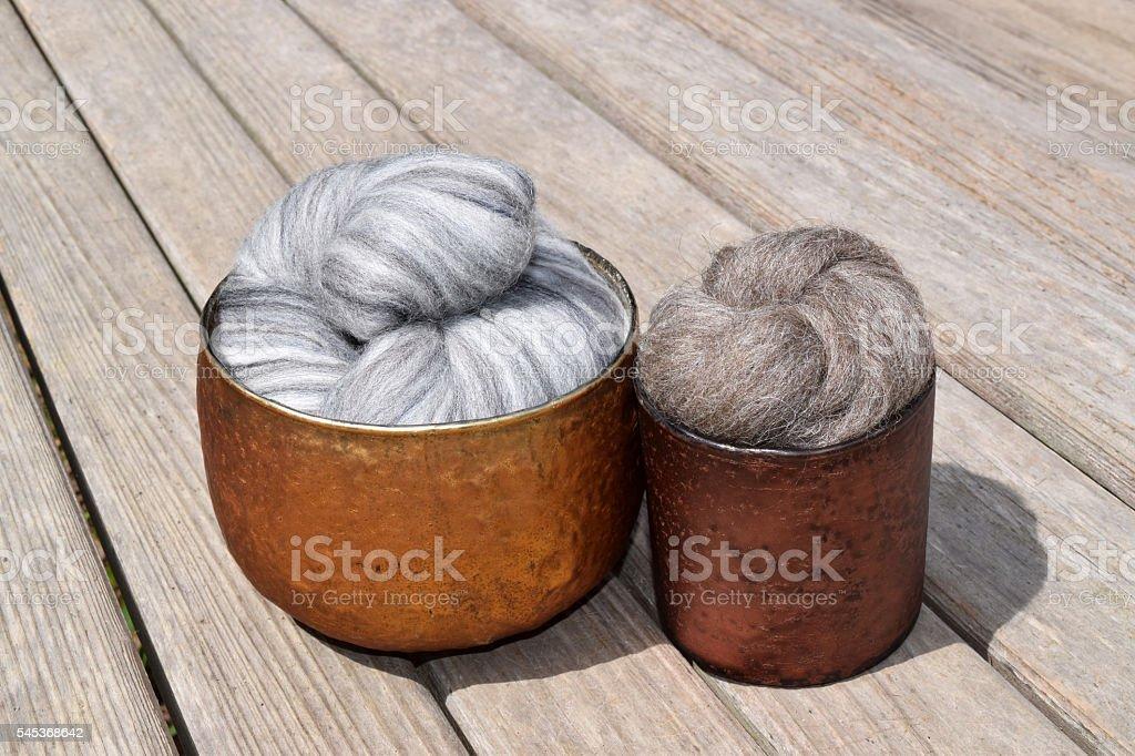 Gray variegated merino and brown top coat sheep wool stock photo