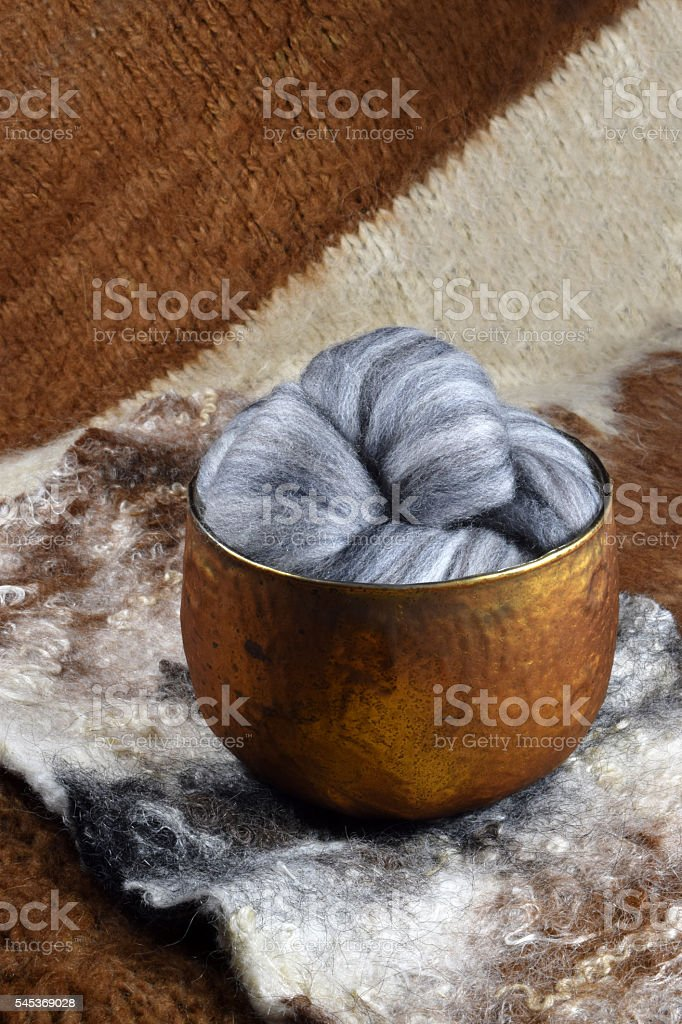 Gray variegated Merino sheep wool stock photo