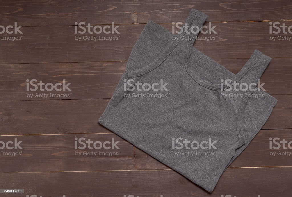 Gray vest is on the wooden background stock photo