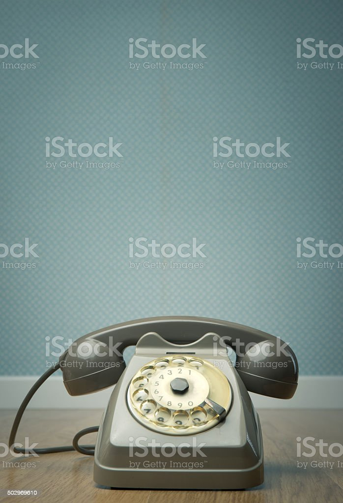 Gray vintage phone on the floor stock photo